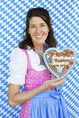 Woman in dirndl with gingerbread — Stock Photo
