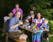 Bavarian family in park — Stock Photo