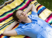 Woman lying in Park — Stock Photo