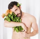 Hombre con rosas — Foto de Stock