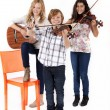 Girls and a boy with musical instruments — Stock Photo #54467181
