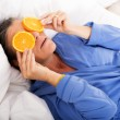 Woman in bed with oranges — Stock Photo #54469009