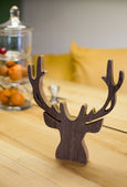 Wooden reindeer on table — Foto de Stock