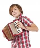 Boy playing accordion — Stock Photo