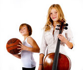 Boy with basketball and girl with double bass — Photo