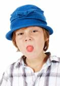Young boy in blue hat is making faces — Stock Photo