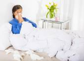 Woman in bed with a cold — Stock Photo