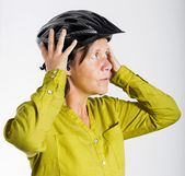Woman with bicycle helmet — Stock Photo