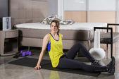 Woman exercising at home — Stock Photo