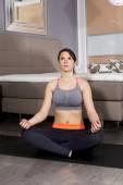 Woman meditating at home — Stock Photo
