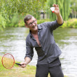 Man playing badminton — Stock Photo #54485277