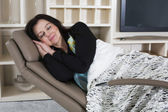 Woman resting in armchair — Stockfoto