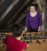 Boy and girl playing at table football — Stock Photo
