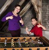 Boy and girl  at table football — Stock Photo
