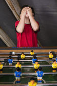 Boy playing table football — Stock Photo