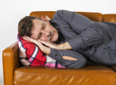 Man laying on couch — Stock Photo