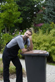Man with trashcan — Stock Photo