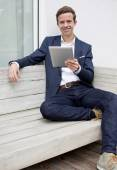 Young man with tablet — Stock Photo