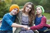 Teenage girl and two boys — Stok fotoğraf