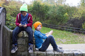 Two boys with phones — Stockfoto
