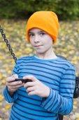 Boy playing on phone — Stock Photo