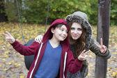 Teenage girl and boy on playground — Stock Photo