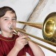 Boy with a trombone — Stock Photo #55986305