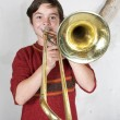 Boy with a trombone — Stock Photo #55986369