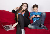 Girl and boy with laptop and phone — Stok fotoğraf