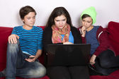 Girl and boys and a laptop — Stok fotoğraf