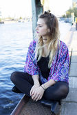 Young woman by the waterfront — Stock Photo