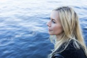 Blond woman by the waterfront — Stock Photo