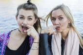 Two women with a painted mustache — Stock Photo