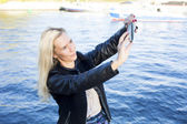 Blond woman taking a selfie — Stock Photo