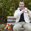 Man on bench shaping heart with his hands — Stock Photo #57316085