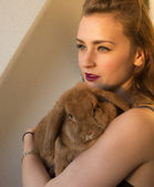 Young woman with a rabbit — Stock Photo
