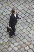 Bird's-eye view of a businesswoman in the street — Stock Photo