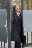 Businesswoman standing at the door — Stock Photo