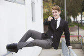Man in suit jumping on a wall — Stock Photo