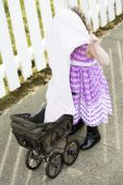 Little girl with pram and blanket over head — Stock Photo