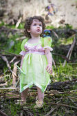Little girl dressed as a fairy with soap bubbles — Stock Photo
