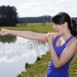 Young woman outdoors in boxing pose — Stock Photo #74786741