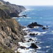 Coastline with cliffs and blue waves — Stock Photo #74788889