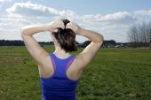 Backside of woman with ponytail outdoors — Stock Photo