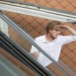 Young man looking out of a rooftop window — Stock fotografie #77286930