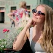 Portrait of young woman wearing retro round sunglasses waiting for a friend — Stock Video #53003857
