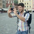 Young casual man with beard taking picture with camera phone outdoors. — Stock Video #53005573