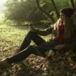 Cheerful stylish young teenage girl taking self photos by phone in autumn park. — Stock Video #55089599