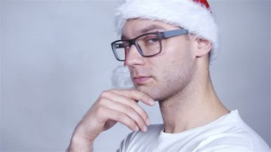 Close up of handsome cheerful christmas man posing in studio. — Stock Video