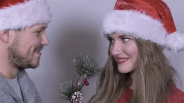 Young beautiful Christmas couple in studio. Slow motion. — Stock Video